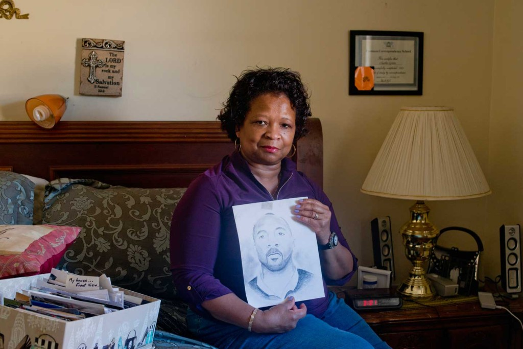 Linda Green with a picture of her husband, Charles. Their son Keshawn was conceived during a conjugal visit, and they raised him together through extended family visits, which are no longer available to Mississippi inmates. (Photograph by Carolyn Drake / Magnum Photos)