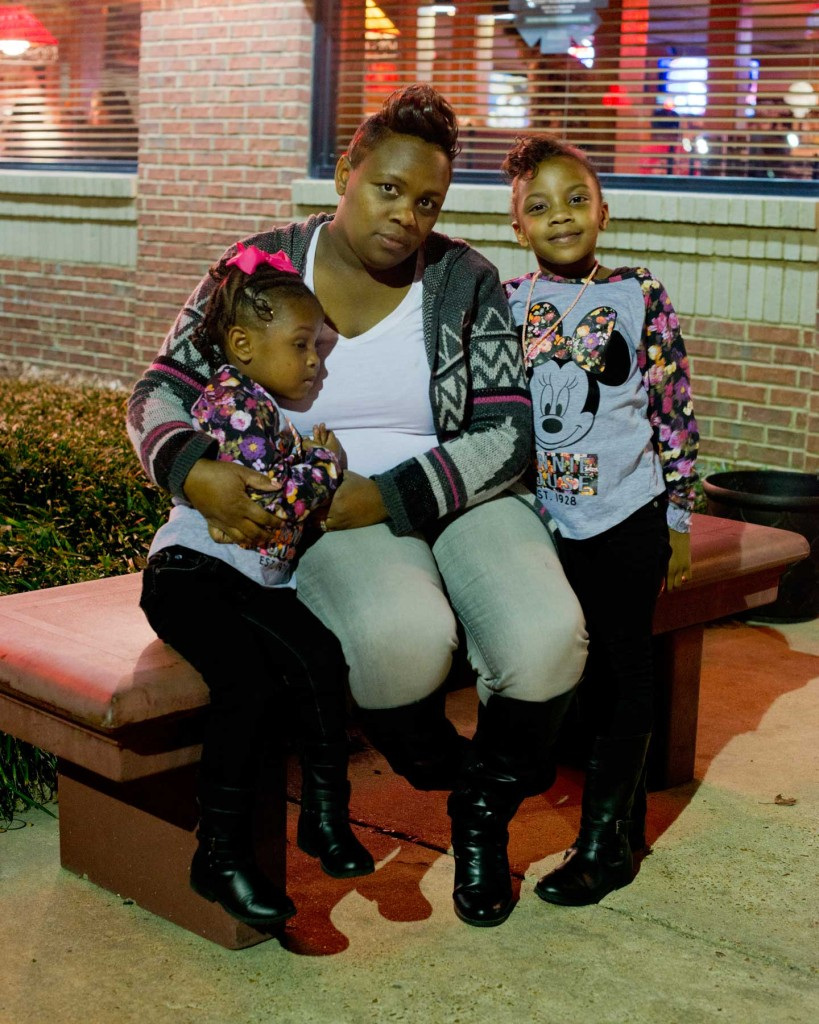 Victoria Phillips with her daughters Amari (right) and Rihanna. Phillips takes the two girls 180 miles across Mississippi so they can visit their dad in prison. (Photograph by Carolyn Drake / Magnum Photos)